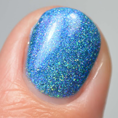 blue nail polish with shimmer close up swatch
