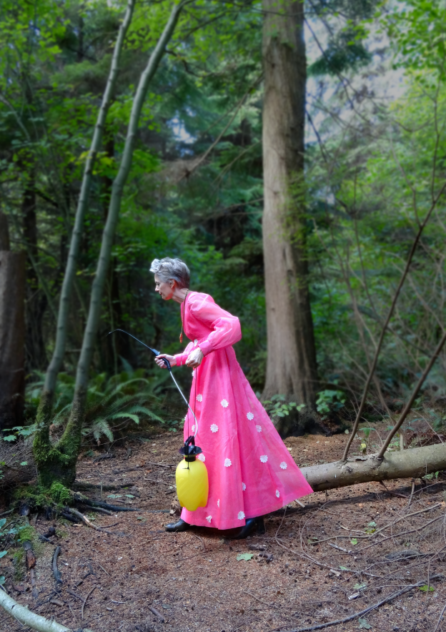 Mel Kobayashi, pink gown in Stanley Park, with sprayer