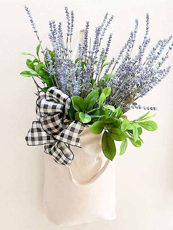 flowers and a bow on a muslin market tote