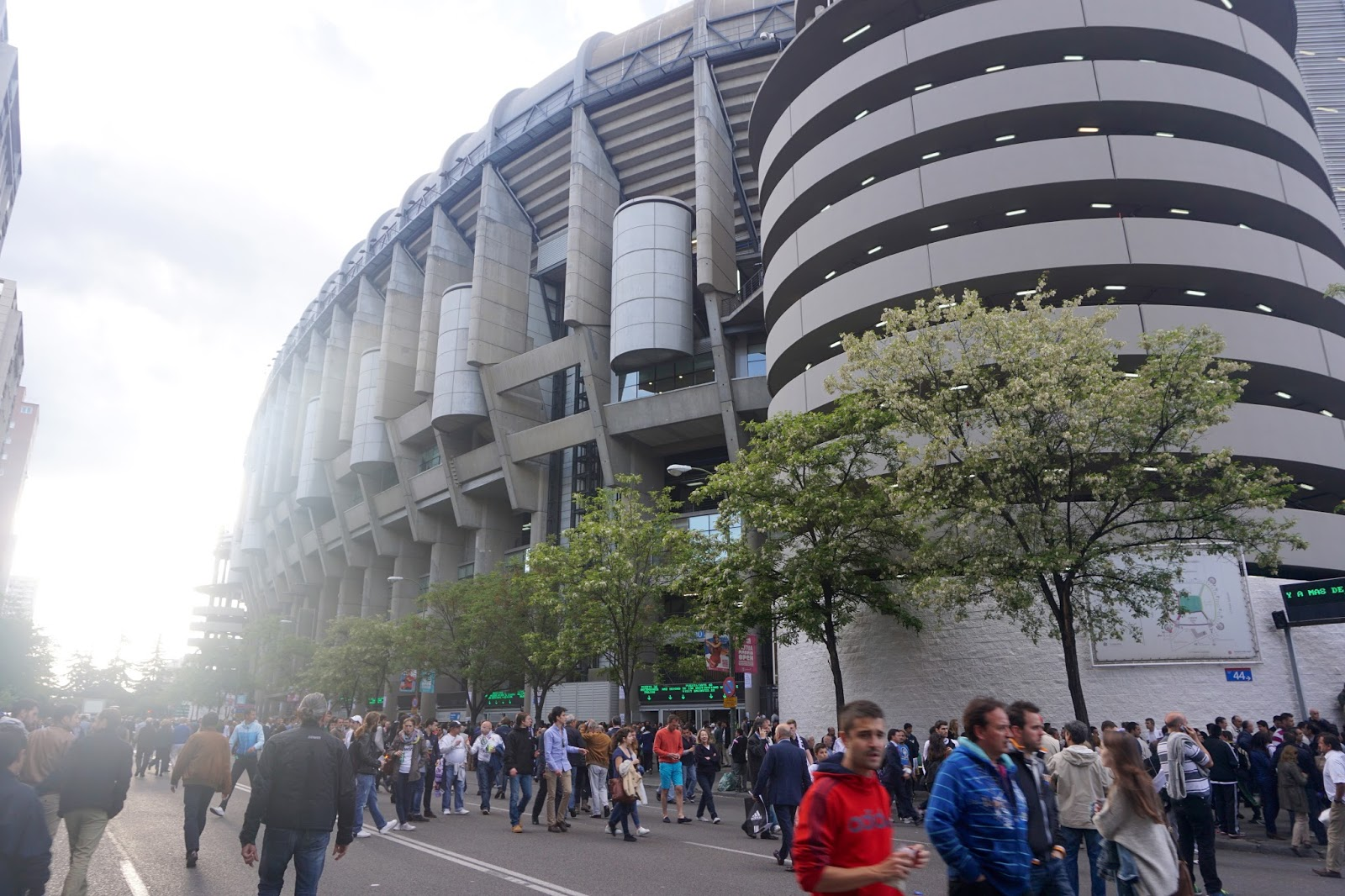 Walking outside Santiago Berbabeu Stadium in Madrid amongst the crowd before a Real Madrid match
