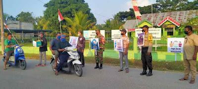 Relawan MRI dan Polsek Simpang Keuramat Bagi-Bagi Masker dii jalan raya