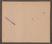 "The back cover of a paper booklet, with a stamp reading ""Made in China."""
