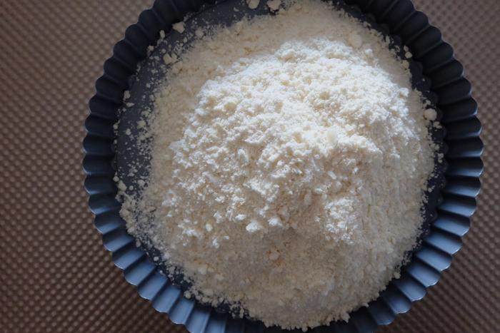 shortbread crust crumbs in pan to be formed