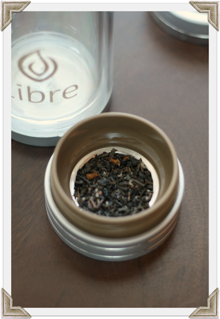 Loose tea in the strainer of a Libre Tea Glass