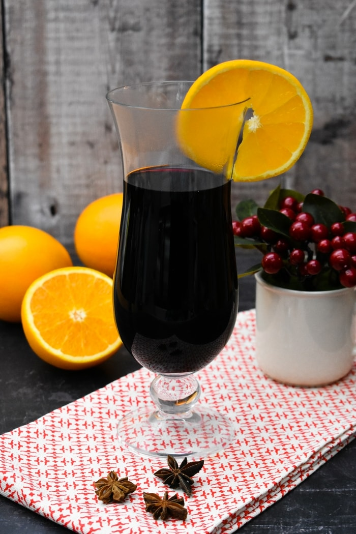 A tall glass of Mulled Wine with Orange Liqueur