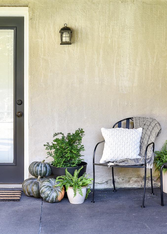 Fall patio decor with pumpkins