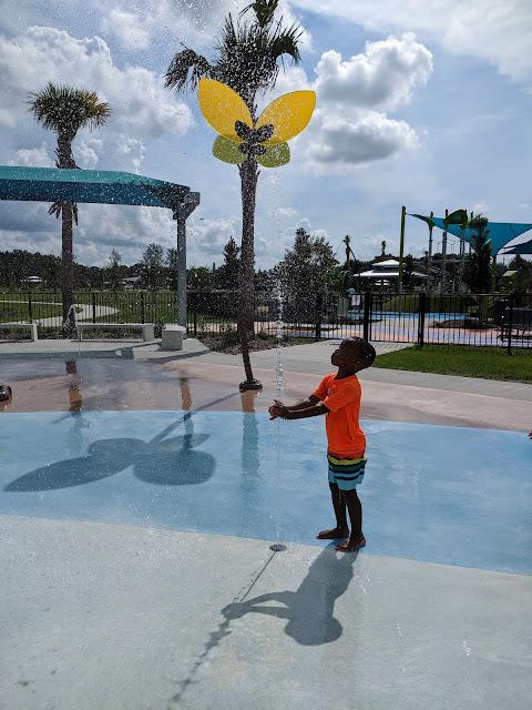preschooler playing at Carrollwood Village Park splash pad