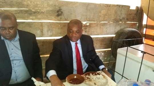 "Former governor of Abia State Orji Uzor-Kalu eats rice and stew at ""mama put"""