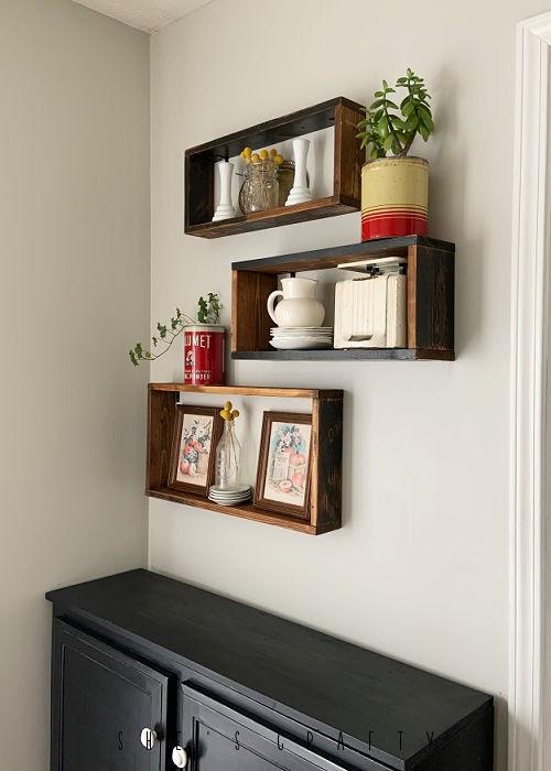 Reclaimed wooden display shelves above kitchen side board.