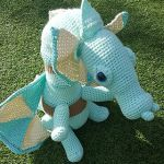 http://www.ravelry.com/patterns/library/helenmay-crochet-magical-dragon