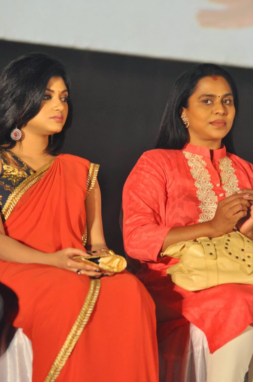 Oviya photos in red saree at madha yaanai koottam movie audio launch
