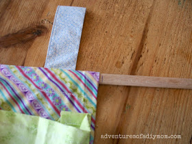 trim dowel and insert it into the shoe organizer