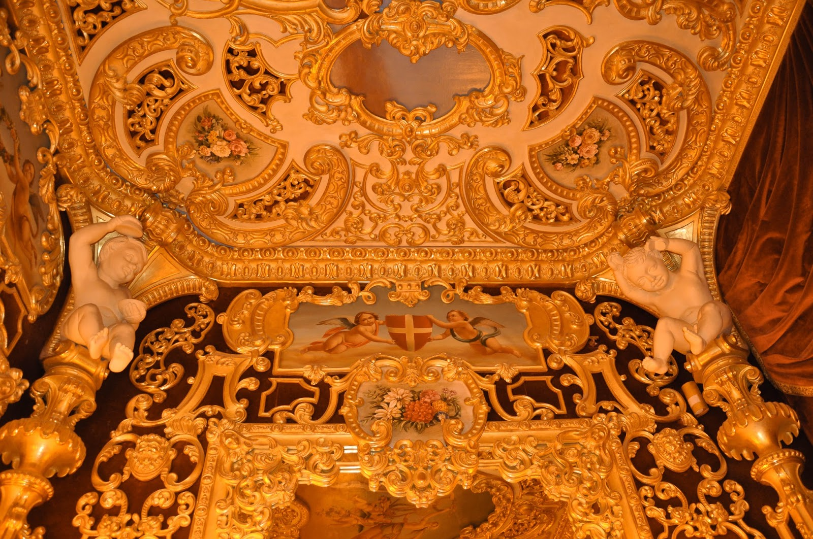Above the mirror inside the royal box, La Fenice, Venice, Italy