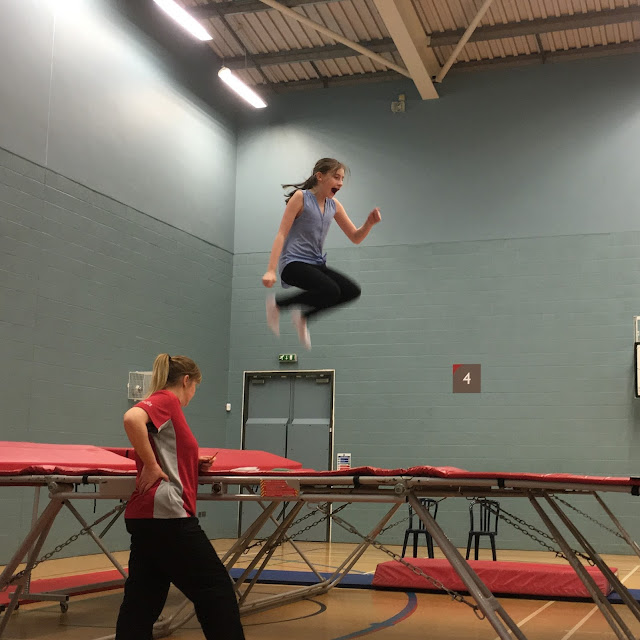 Sasha jumping high on trampoline