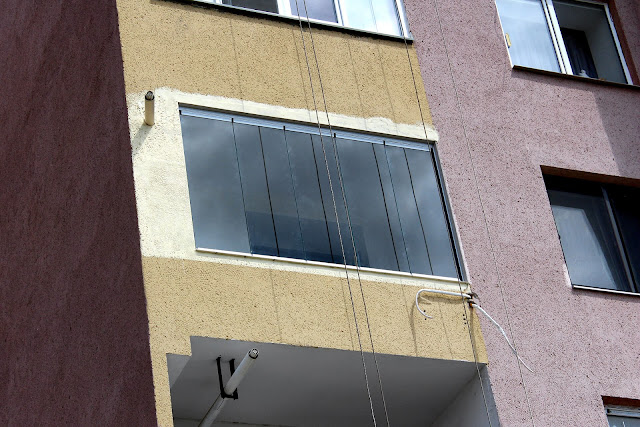 Frameless glazing of balconies and loggias