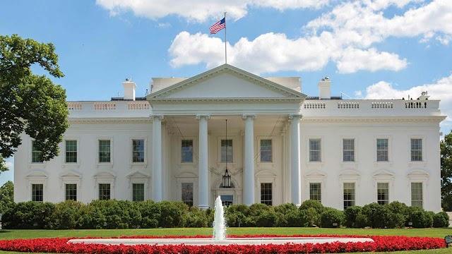 White House denies seeking to control Michael Flynn