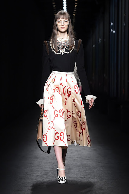 https://www.gucci.com/us/en/pr/women/womens-ready-to-wear/womens-skirts/guccighost-skirt-p-430556ZHX739186?position=6&listName=SearchResultGridComponent