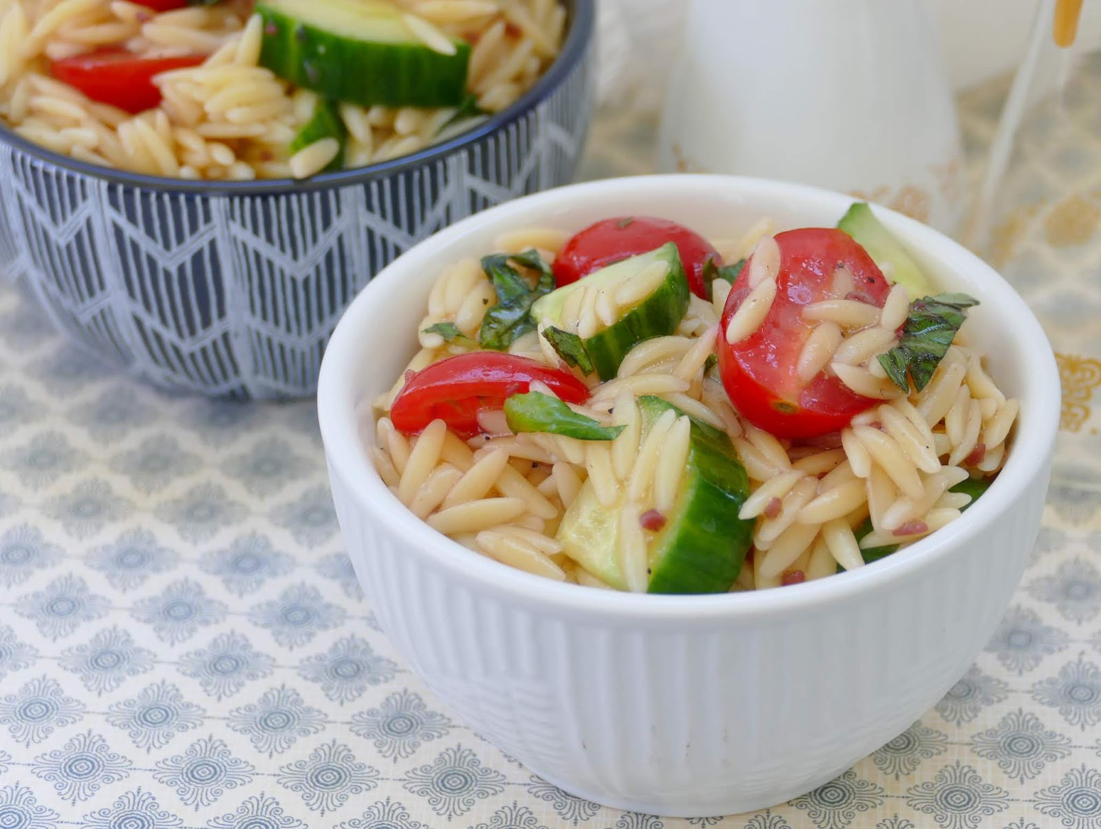 This simple spring or summer orzo pasta salad couldn't be any easier! The tomatoes, basil and cucumber combined together adds the perfect taste and texture to the orzo, and the vinaigrette dressing is the perfect finishing touch. Great side for lunch, dinner, any picnic, BBQ or potluck!