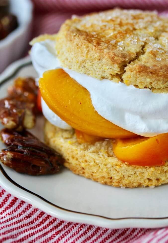 Peach Cornmeal Shortcakes with Pecans and whipped cream