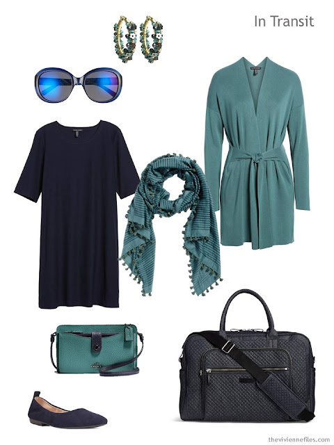 travel outfit of a navy dress with muted teal cardigan and accessories