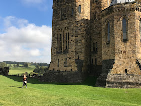 outside alnwick castle on a sunny day
