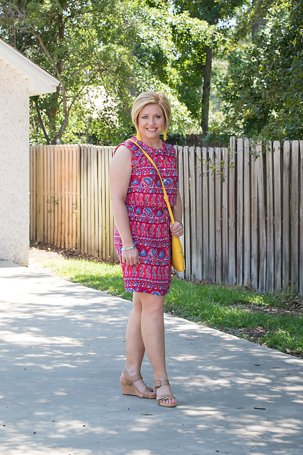 Tassel earrings and wedges with print dress