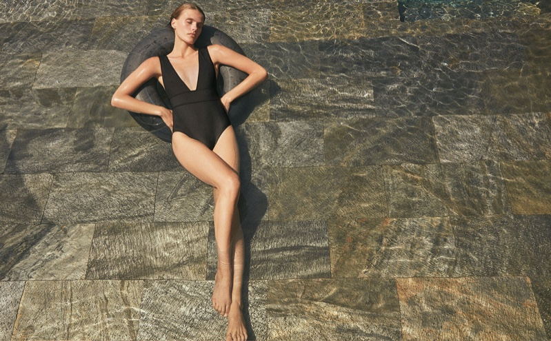 Model Madison Headrick wears a black one-piece swimsuit in Eres spring-summer 2020 campaign