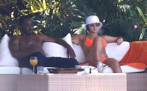 Diddy goes shirtless as he relaxes in Miami Beach with a bikini clad mystery woman [photos]