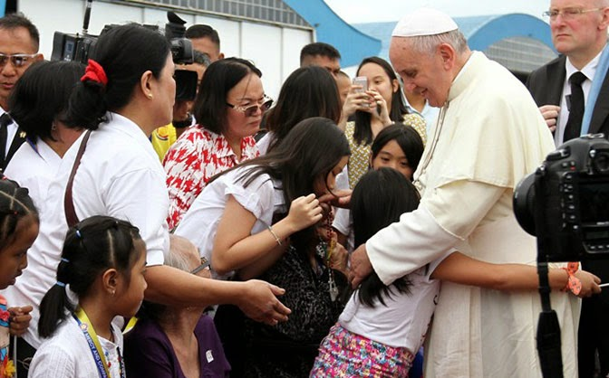 Pope Francis hugs children