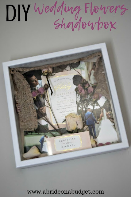 Preserve your wedding items with a beautiful DIY Wedding Flowers Shadowbox. Get the tutorial to make one on www.abrideonabudget.com.