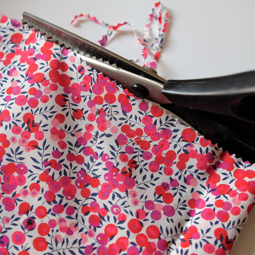 Zigzag shears help prevent fraying when prewashing fabric for Applique.  Tutorial for No Sew Fabric Applique with HTV Edging from Silhouette UK Blog