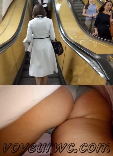 Upskirts 4044-4053 (Secretly taking an upskirt video of beautiful women on escalator)