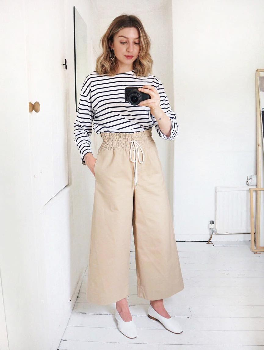 5 Casual-Cool Ways to Wear a Striped T-Shirt for Spring — Brittany Bathgate Instagram Look with paperbag waist pants and white minimalist flats