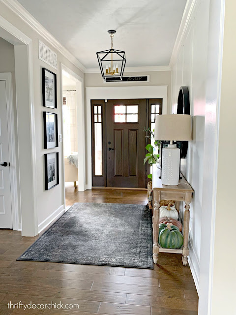 large foyer with craftsman door and windows