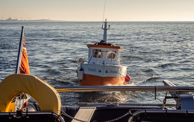 Photo of Ravensdale towing a fishing boat back to Maryport Marina in Cumbria, UK