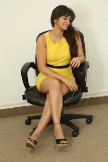 Actress Harshika Poonacha Stills in Yellow Short Dress at Appudala Ippudila Movie Promotions  0093.jpg