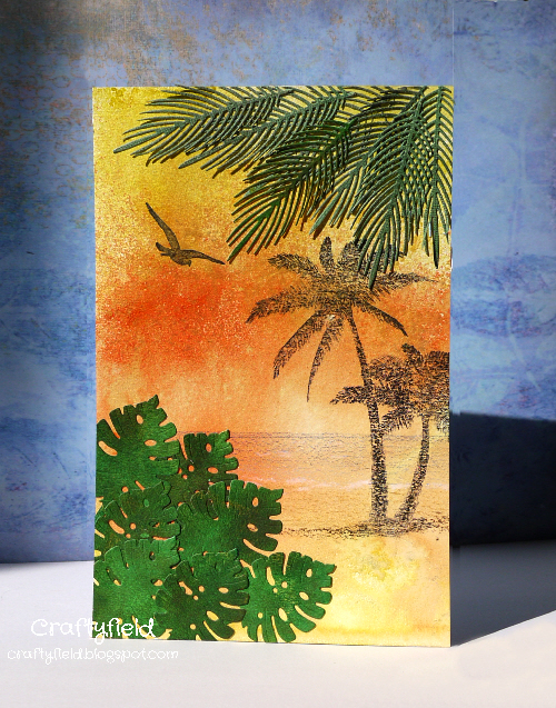 Beach scene created with stamps and dies