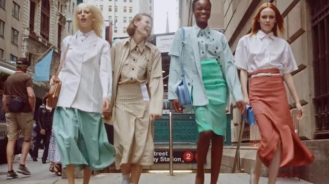 Women in work attire walking on street
