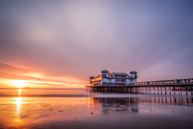 Weston-Super-Mare Grand Pier in a long exposure image at sunset