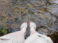 My feet in a stream, taken two years ago, to remind me that I have to craft new experiences now.