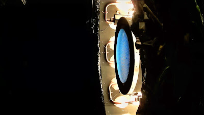 This image shows the NEXT-C flight thruster operating within the vacuum chamber during thermal vacuum testing. Photo credit: NASA