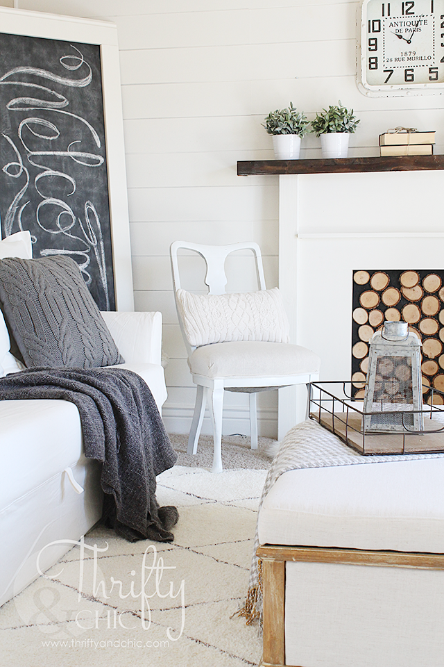 White farmhouse decorating ideas for the living room with DIY shiplap and faux fireplace