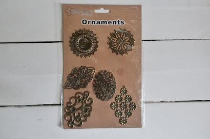 Metalowe ornamenty Action