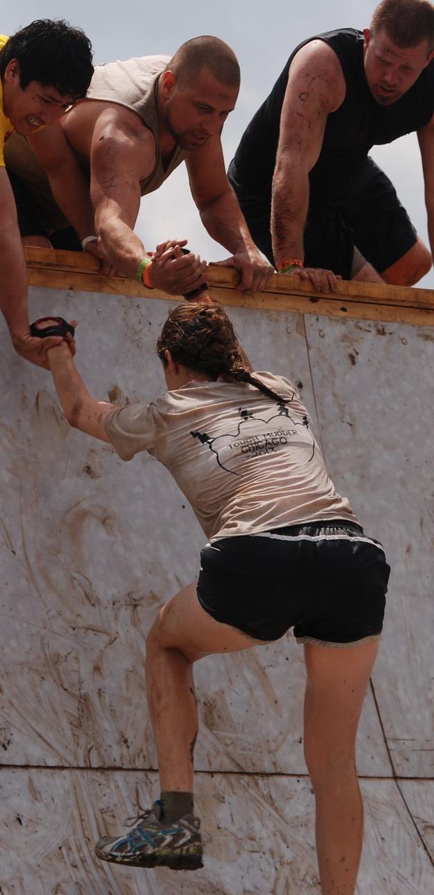 Helping a girl climb.