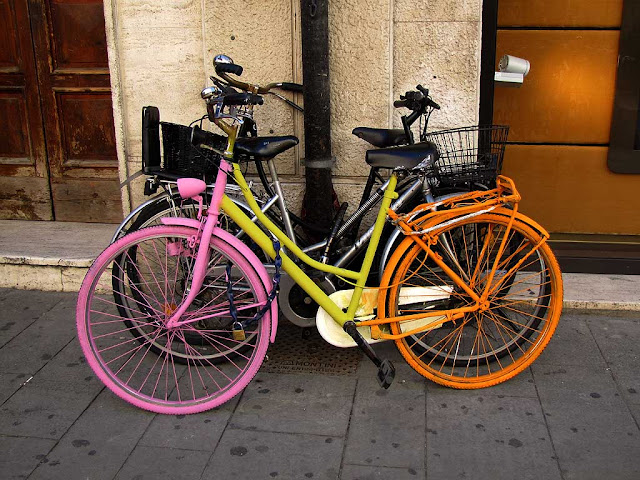 Pink, yellow and orange bicycle, via del Giglio, Livorno