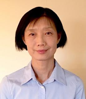 A portrait photo of Dr. Feng