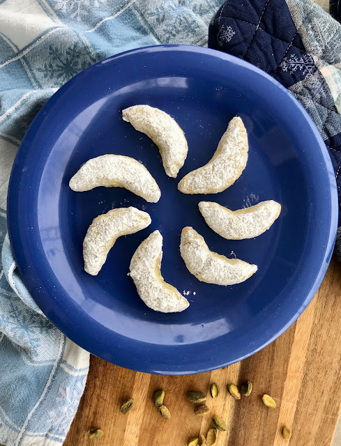Buttery shortbread crescent cookies made with ground pistachios and cardamom make a lovely addition to your holiday dessert tray. The aroma and sweet taste of cardamom pairs nicely with the pistachios.