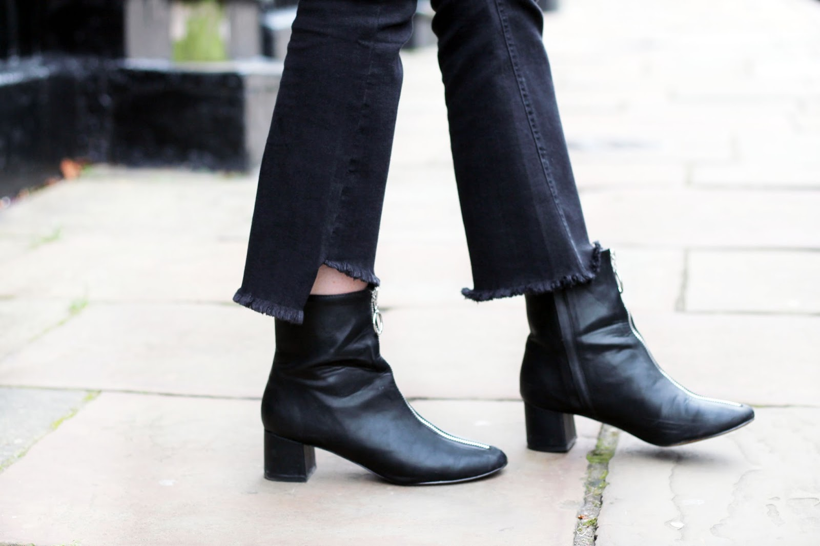 black crop kick flare jeans with distressed hem and black ankle boots