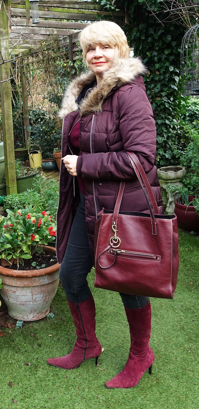 Fur trimmed burgundy insulated parka coat from Oasis, ideal for the wet and windy UK winter weather