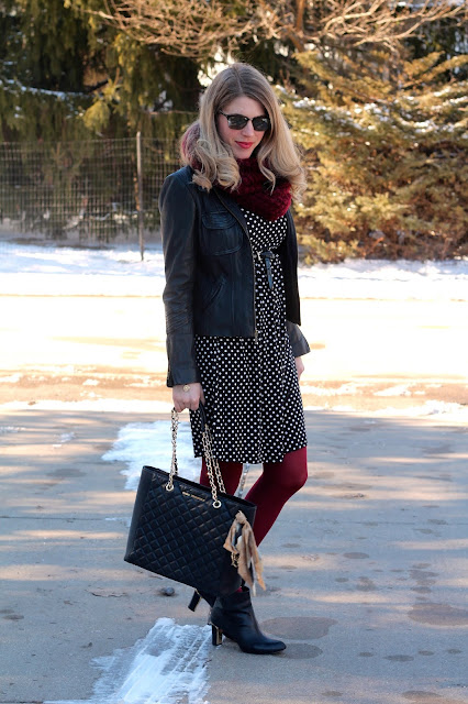 black polka dot dress, leather moto jacket, red tights, burgundy scarf, black booties
